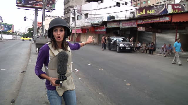 sky news reporter sherine tadros is in shaja'iya and witnessed the immediate aftermath of air strikes a warning that her report contains distressing... - 2014 stock videos and b-roll footage