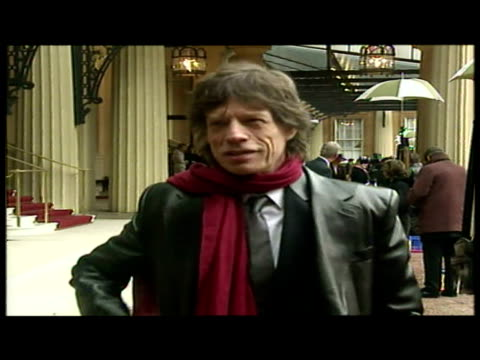 sky news reporters talks to mick jagger on the day he received his knighthood from prince charles. sky news archival content of rolling stones at... - audio hardware stock videos & royalty-free footage