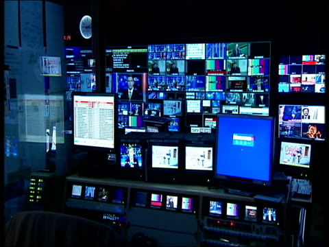 sky news studios people working in news control room or gallery with multiple screens and picture monitors / programme editor giving instructions... - control room stock videos & royalty-free footage