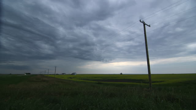 sky over field - telegraph pole stock videos and b-roll footage