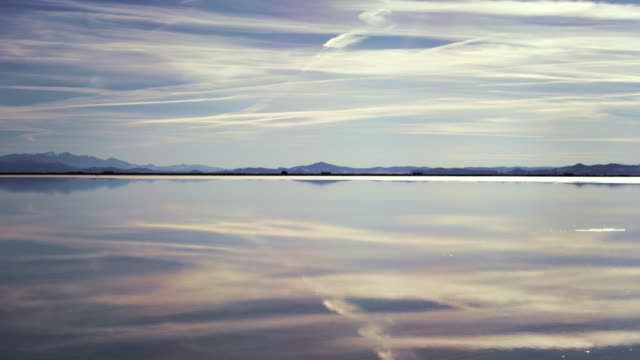 sky reflected in water covered salt flats time lapse - bonneville salt flats stock videos and b-roll footage