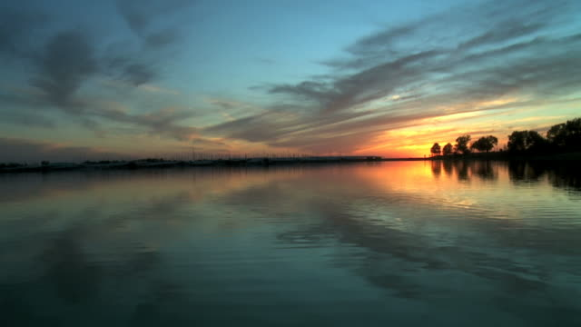 sky reflecting off water at sunset - marina stock videos & royalty-free footage