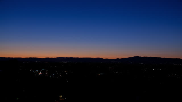 ws t/l sky sets over city skyline / studio city, california, united states  - studio city stock videos & royalty-free footage