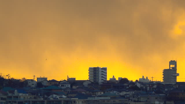sky with clouds over the evening city with sunset - satoyama scenery stock videos & royalty-free footage