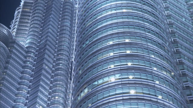 a skybridge connects the petronas towers. - petronas twin towers stock videos & royalty-free footage