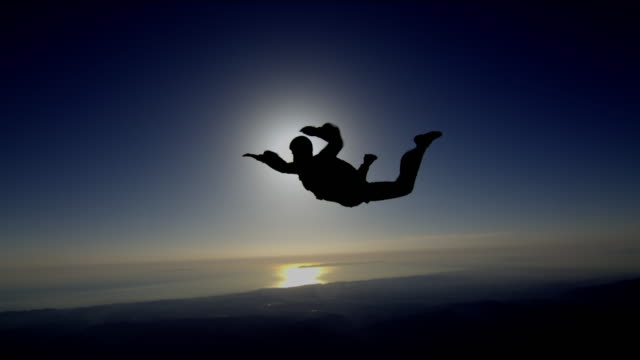 skydiver backlit - parachuting stock videos and b-roll footage