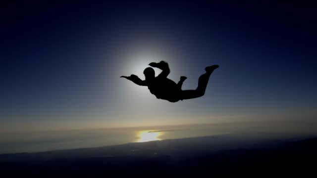 Skydiver backlit