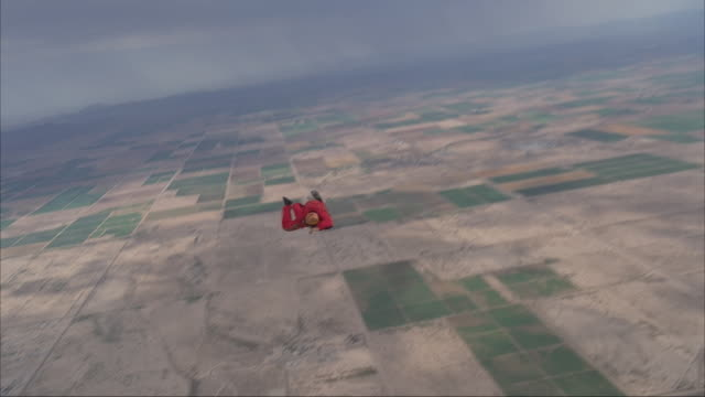 Skydiver deploying parachute