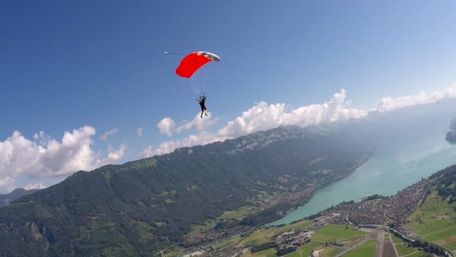 skydiver descending with open parachute - air to air shot stock videos & royalty-free footage