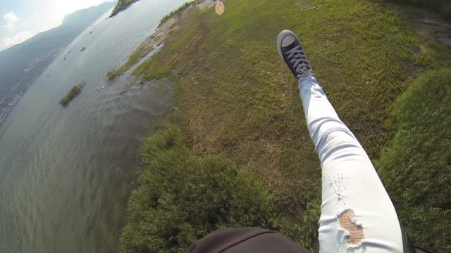 POV of skydiver descends and landing