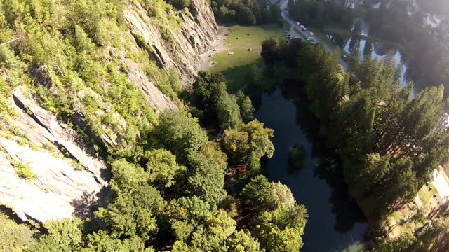 POV of skydiver descends to meadow