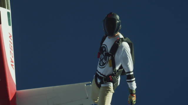 skydiver exits airplane - free falling stock videos & royalty-free footage