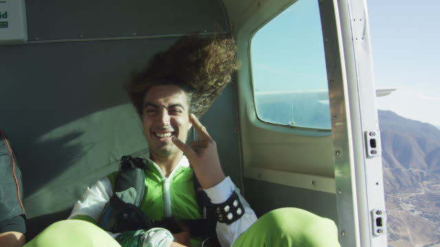 skydiver hair blowing - millennial generation stock videos & royalty-free footage
