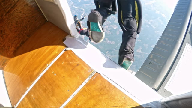skydiver jumping off the plane - point of view stock videos and b-roll footage