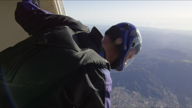 skydiver looks out the open door of an airplane - anticipation stock videos and b-roll footage