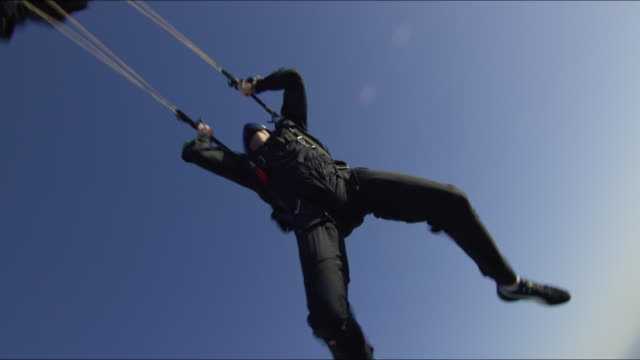 Skydiver opens his parachute
