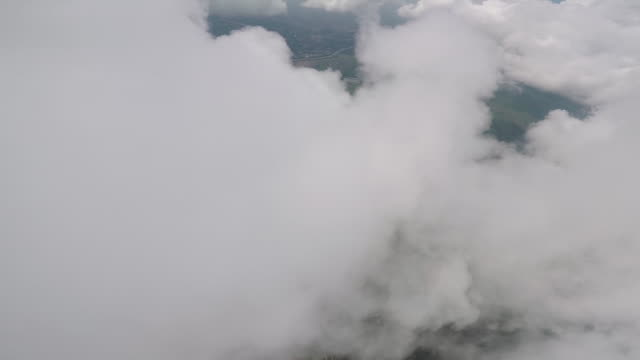 skydiver perspective of descending through lofty clouds - skydiving stock videos & royalty-free footage