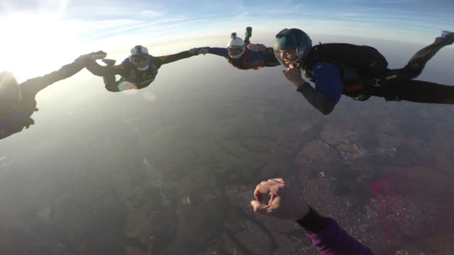 skydiver point of view of circle skydiving formation - point of view video stock e b–roll