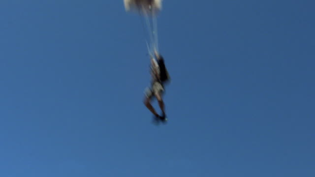 a skydiver releases a parachute. available in hd. - releasing stock videos & royalty-free footage