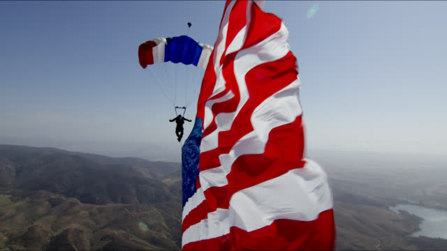 Skydiver tows American flag