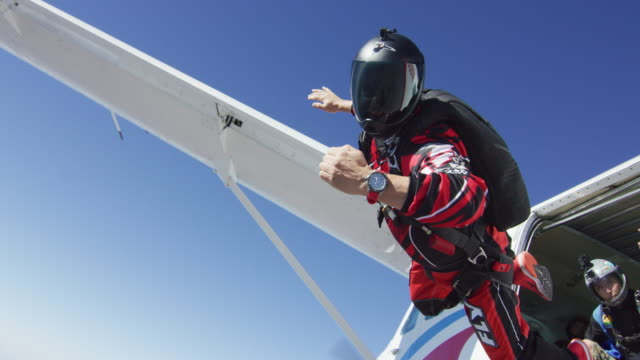 skydiver with wristwatch exits airplane - exhilaration stock videos & royalty-free footage