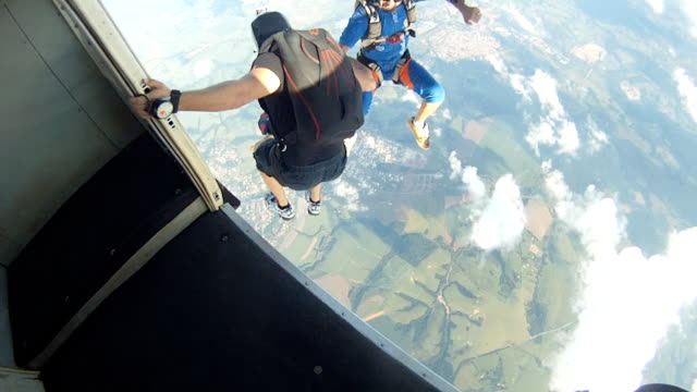 skydivers exit from the plane - jumping stock videos & royalty-free footage