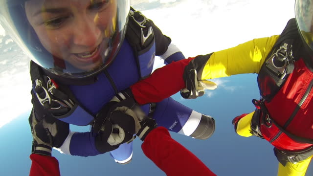 skydivers fall from airplane, supported by leader - quartet stock videos & royalty-free footage