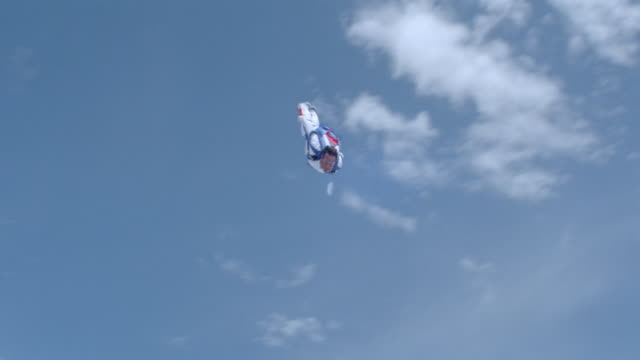 skydivers free fall through the air above the clouds. - free falling stock videos & royalty-free footage