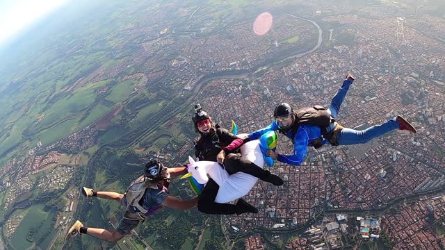 skydivers having fun with a unicorn float in free fall. - comedian stock videos & royalty-free footage