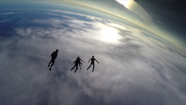 skydivers jump from helicopter, perform aerial acrobatics - helicopter tour stock videos and b-roll footage