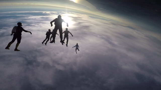 skydivers jump from helicopter, perform aerial acrobatics - helicopter point of view stock videos and b-roll footage