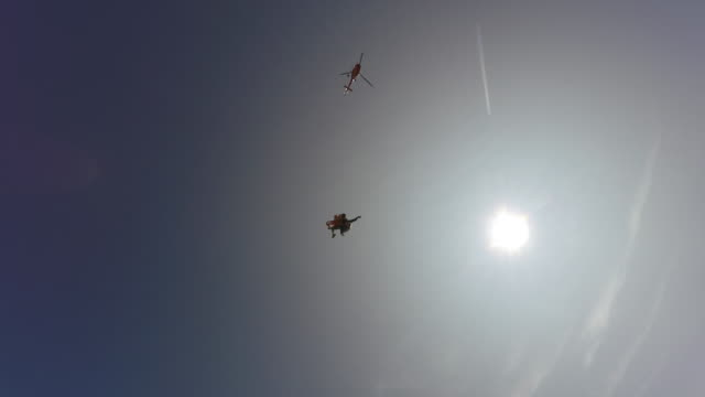 Skydivers jumping from helicopter