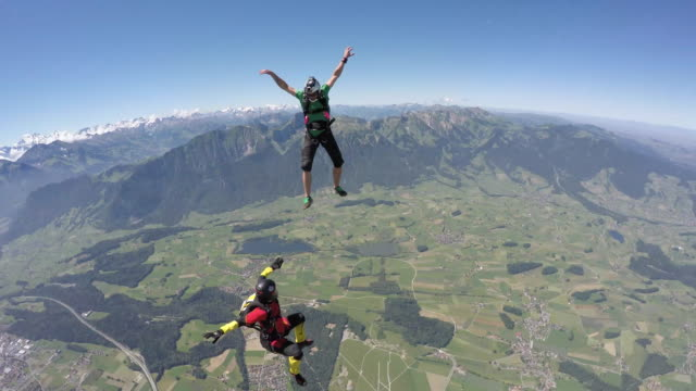 Skydivers perform acrobatic moves in freefall