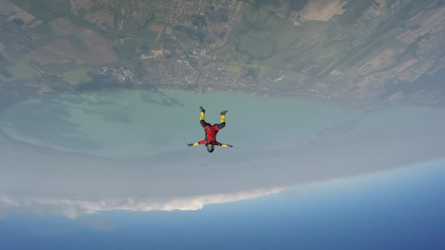 skydivers performing acrobatics in freefall - free falling stock videos & royalty-free footage