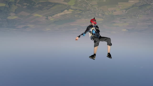 Skydivers performing acrobatics in freefall