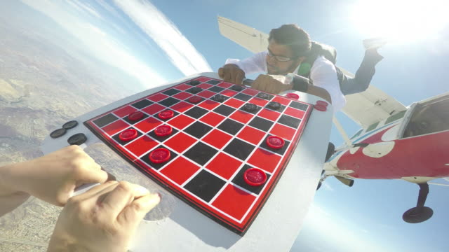 skydivers play a game of aerial checkers - gopro pov - draughts stock videos & royalty-free footage