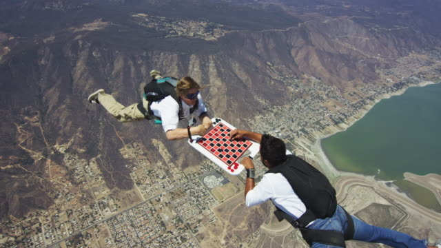 skydivers play a game of aerial checkers - draughts stock videos & royalty-free footage