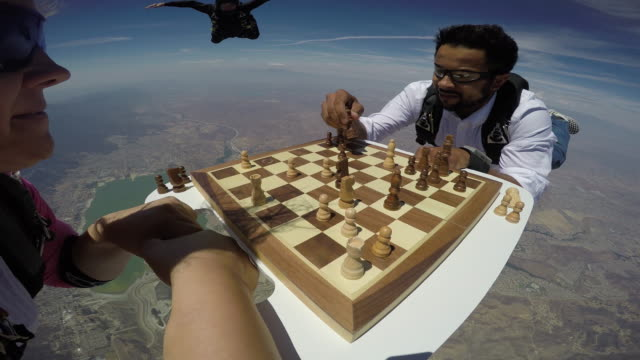 vídeos de stock, filmes e b-roll de skydivers play a game of aerial chess - gopro pov - exultação