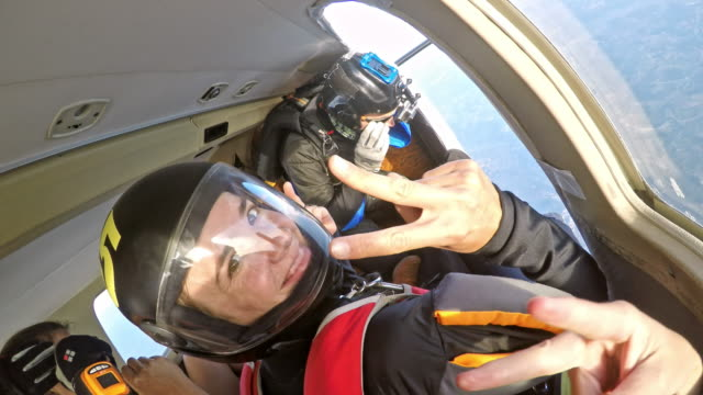 skydivers preparing to jump off the plane - parachuting stock videos and b-roll footage