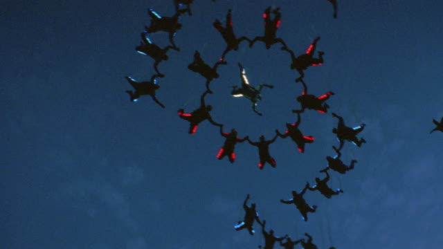 skydivers wearing lighted suits free fall in formation at night. - skydiving stock videos & royalty-free footage