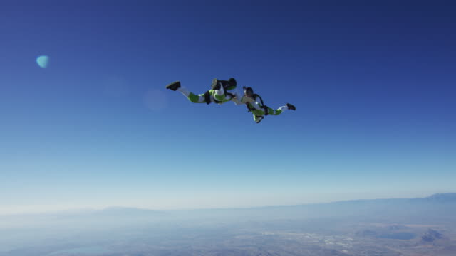 skydiving backgammon - one of 10 clip series - inspiration board stock videos and b-roll footage