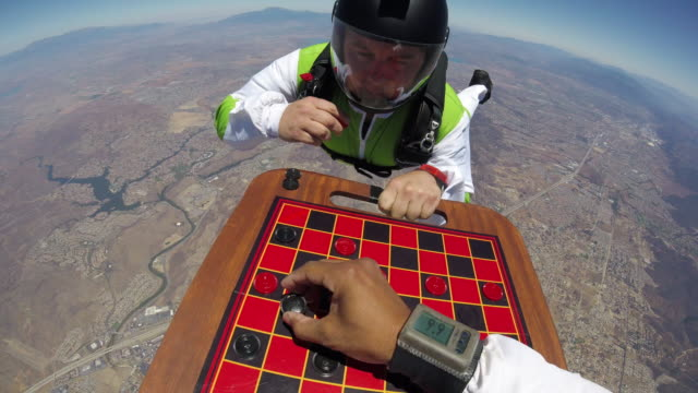 skydiving checkers game pov - business relationship stock videos and b-roll footage