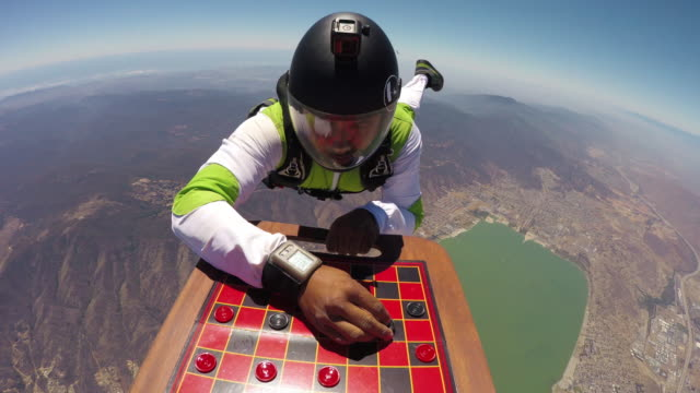 skydiving checkers game pov - leisure games stock videos & royalty-free footage
