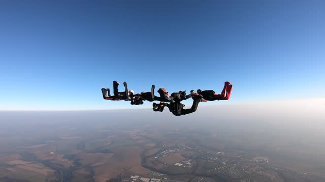 skydiving group formation - arrangement stock videos & royalty-free footage