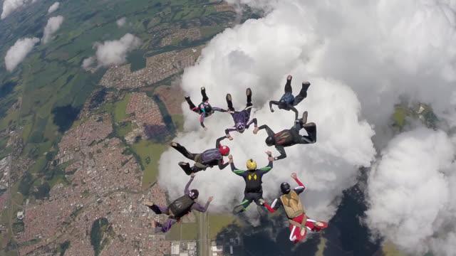 skydiving group teamwork - circle stock videos & royalty-free footage