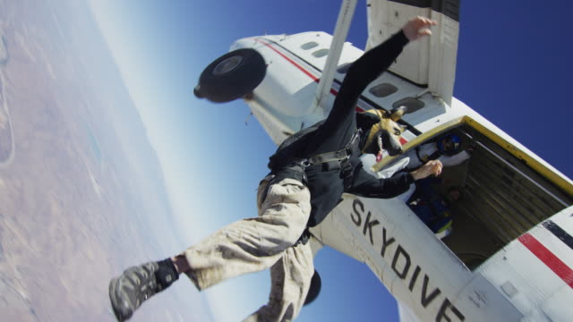 skydiving in dog mask - airplane exit - exhilaration stock videos & royalty-free footage