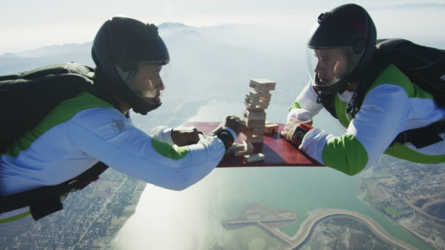 skydiving jenga game - conquering adversity stock videos & royalty-free footage