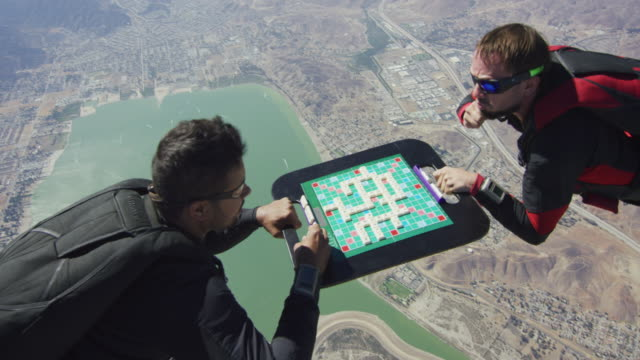 vídeos de stock, filmes e b-roll de skydiving scrabble game - estupefação