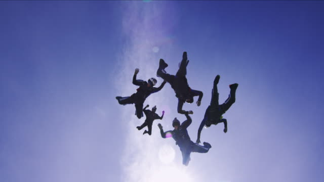 skydiving team - silhouette - parachuting stock videos and b-roll footage
