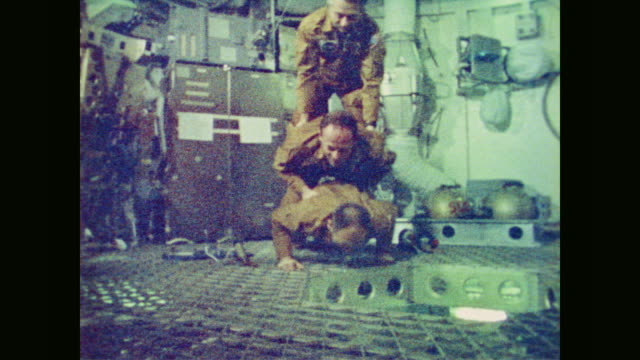 skylab crew gerald p. carr, edward g. gibson and william r. pogue do pushups in space - bodyweight training stock videos & royalty-free footage